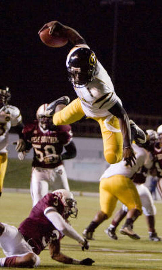 Grambling State quarter back catches some air as he leaps for a touchdown in the second quarter against TSU on Thursday. Photo: Nick De La Torre, CHRONICLE