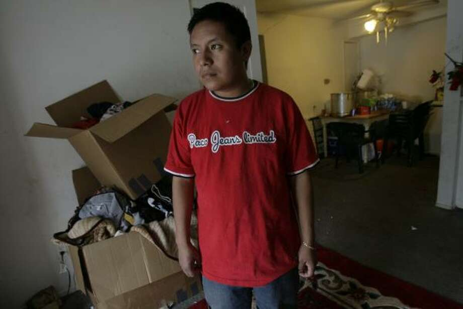 Adolfo Chavez, 27, with belongings of brother Arturo, reflects Wednesday in Webster on the teen's apparent hanging 48 hours after Arturo's arrest. Officials are still investigating his death, which has been ruled a suicide. Photo: JULIO CORTEZ, CHRONICLE
