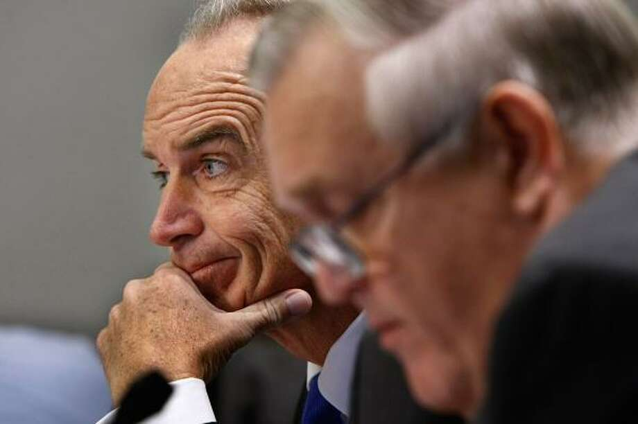 Interior Secretary Dirk Kempthorne, left, and Interior Inspector General Earl Devaney take questions on Capitol Hill on Thursday. Photo: CHIP SOMODEVILLA, GETTY IMAGES
