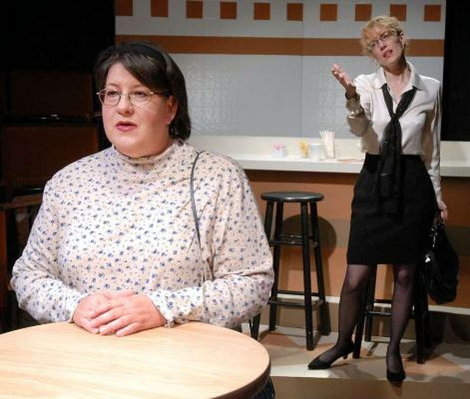 Michelle Britton, front, plays Haddie, and Gwendolyn McLarty plays Sylvia in  ...  and L.A. Is Burning, premiering at Main Street Theater. Photo: DAVE ROSSMAN, FOR THE CHRONICLE