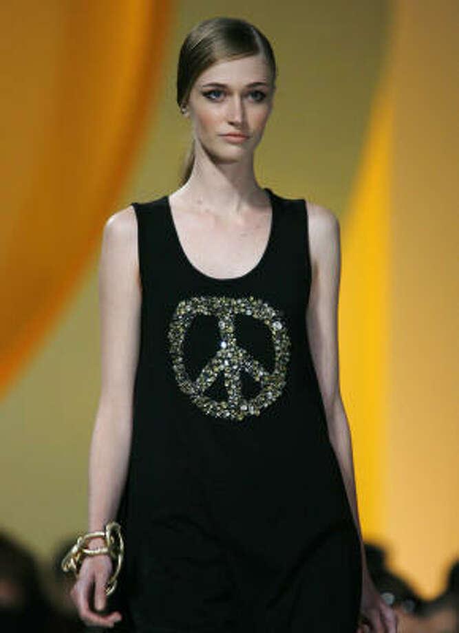 A dress from Moschino features a glittery peace symbol. Photo: ALBERTO PELLASCHIAR, Associated Press