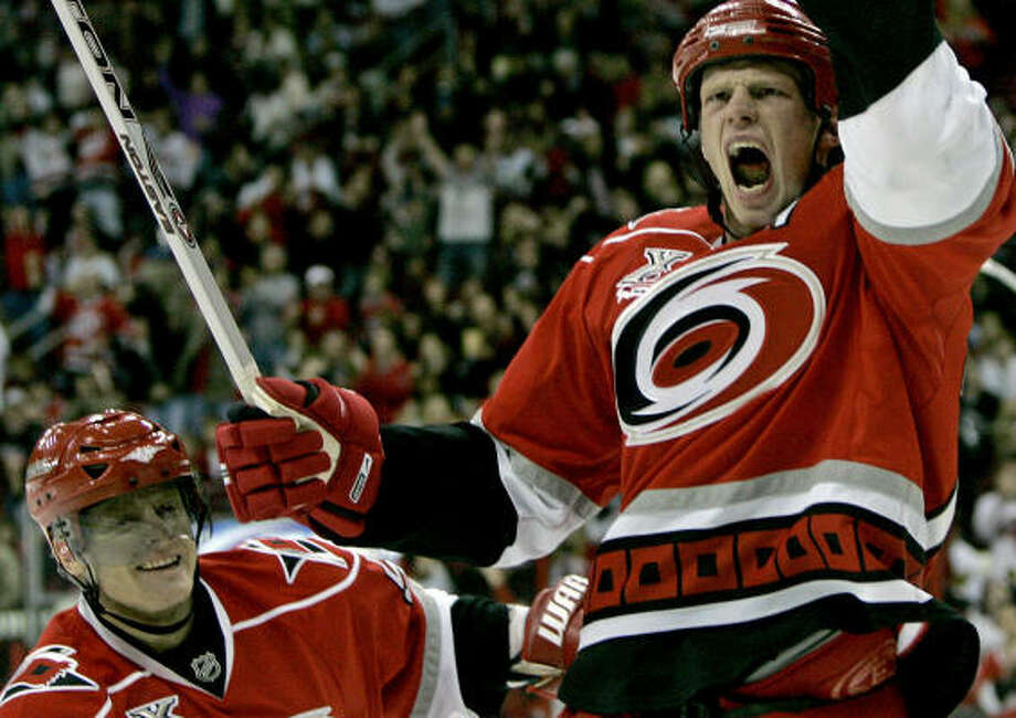 Carolina's Eric Staal, right, celebrates his goal with teammate Jeff Hamilton in the second period. Photo: Gerry Broome, AP