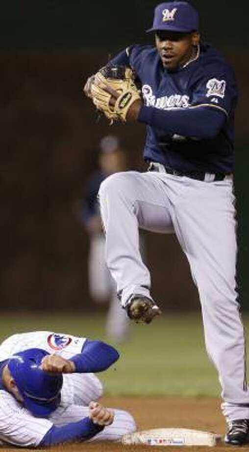 The Brewers' Rickie Weeks, right, tries to avoid Mark DeRosa after forcing him out in the sixth. Photo: NAM Y. HUH, ASSOCIATED PRESS