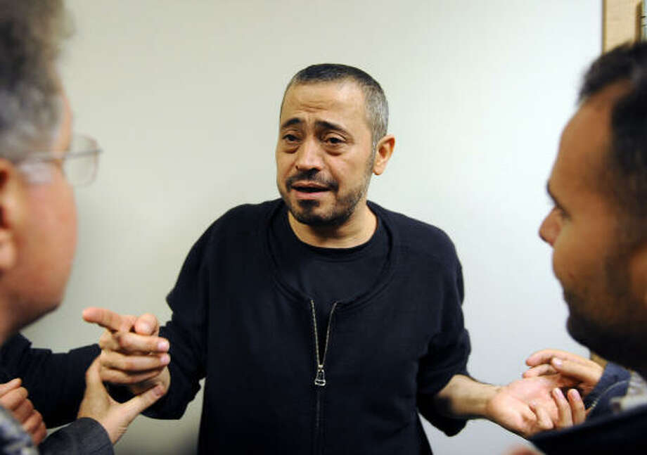 Lebanese-Syrian singer George Wassouf, talks to relatives after a Stockholm judge decided not to remand Wassouf in custody. Photo: OLIVIER MORIN, AFP/Getty Images