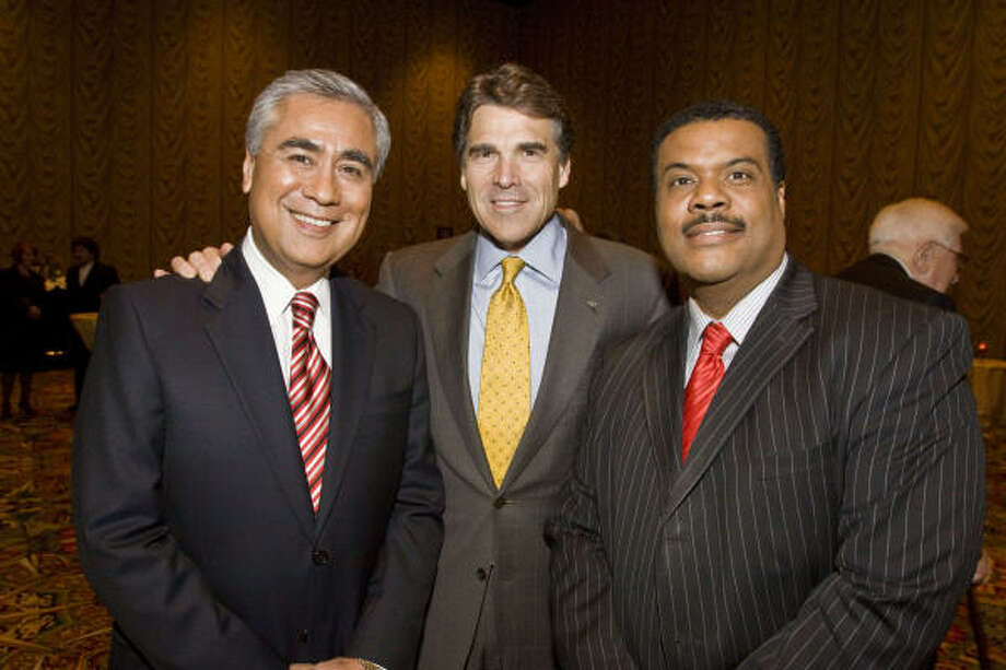 "Bill Balleza, Governor Rick Perry, and Jose Grinan at the ""Goodnight Neighbors"" evening benefiting the Ron Stone Foundation. Photo: Bill Olive"