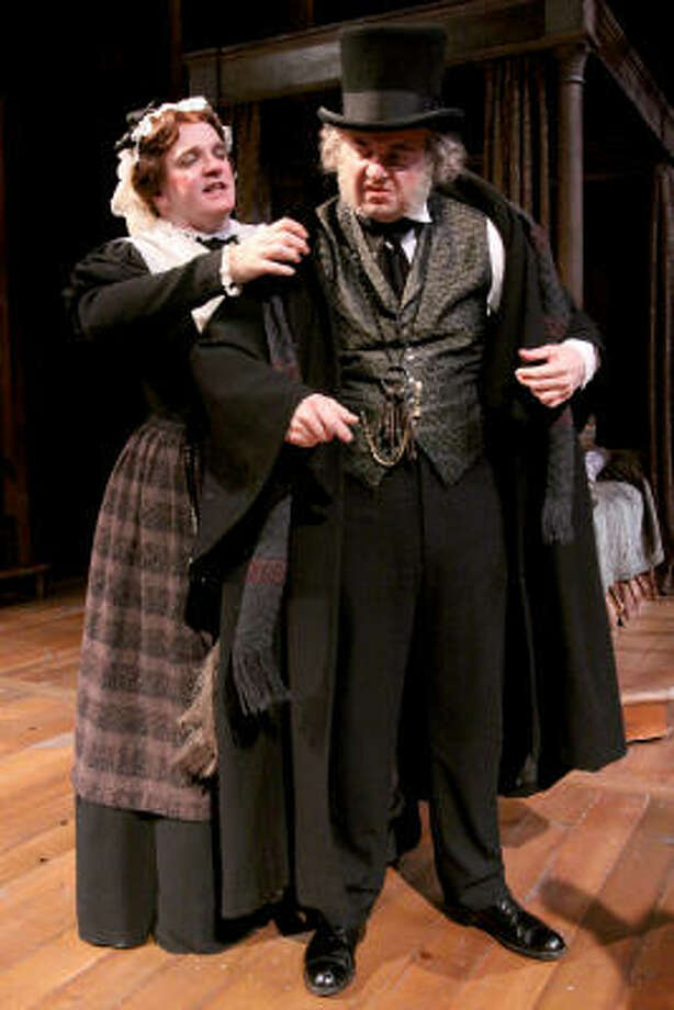 Jeffrey Bean as Scrooge, and James Black as Mrs. Dilber in A Christmas Carol. Photo: Bill Olive, For The Chronicle