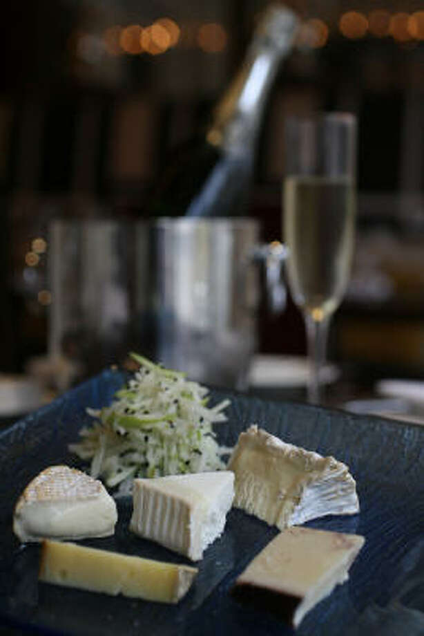 Sommelier Evan Turner serves a variety of full-bodied cheeses with champagne and his apple-jicama slaw at 17 restaurant in the Alden Hotel. Photo: MAYRA BELTRAN PHOTOS:, CHRONICLE
