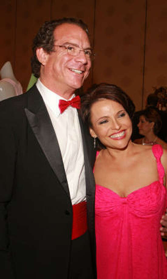 Chairs Lucia and Michael Cordúa at the Susan G. Komen Foundation Pink Tie Gala Photo: Gary Fountain, For The Chronicle