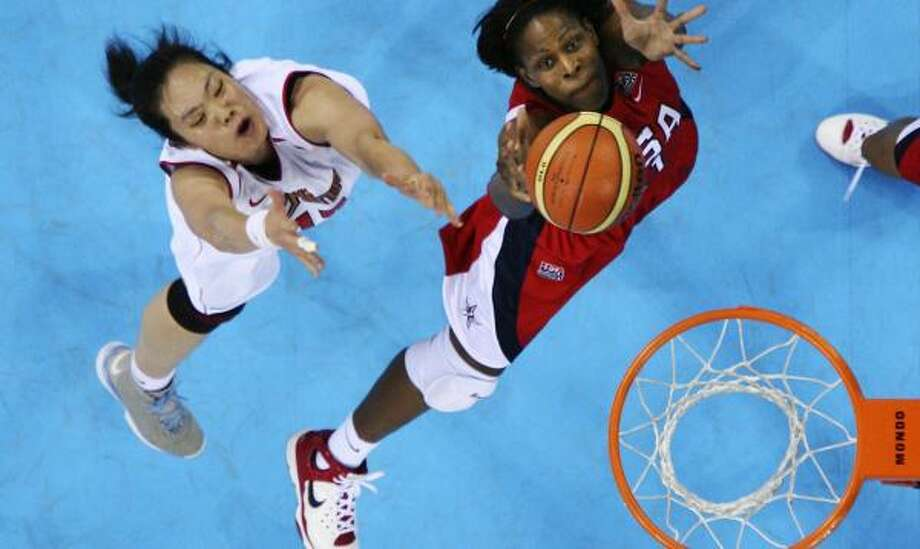 Taj McWilliams-Franklin (in red) was traded after Candace Parker joined the Sparks. Photo: Robert F. Bukaty, AP