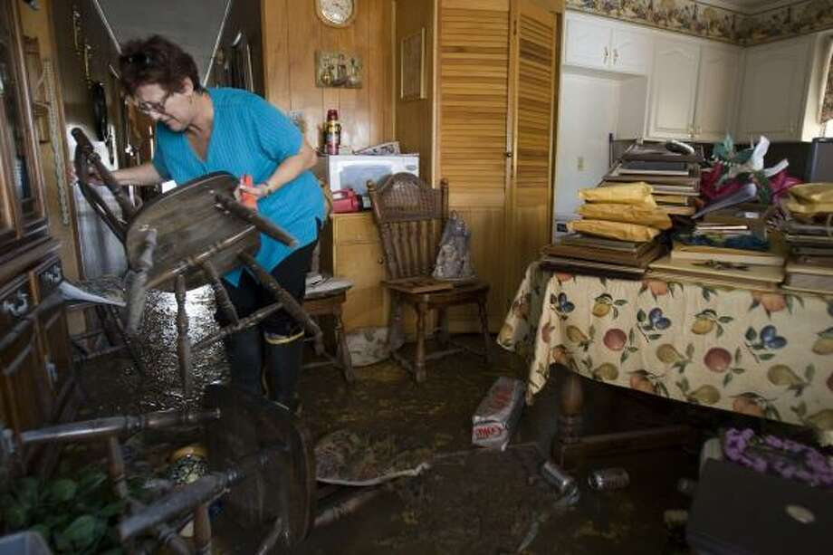 Many Galveston Island residents who got through the long wait — like Tina Arcidiacono — found mud everywhere, if their homes were there at all. Photo: BRETT COOMER, CHRONICLE