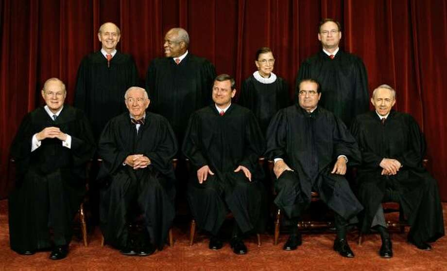Members of the U.S. Supreme Court are, front row from left, Associate Justice Anthony M. Kennedy, Associate Justice John Paul Stevens, Chief Justice John G. Roberts, Associate Justice Antonin Scalia and Associate Justice David Souter; and standing from left, Associate Justice Stephen Breyer, Associate Justice Clarence Thomas, Associate Justice Ruth Bader Ginsburg and Associate Justice Samuel Alito Jr. Photo: J. SCOTT APPLEWHITE, ASSOCIATED PRESS FILE