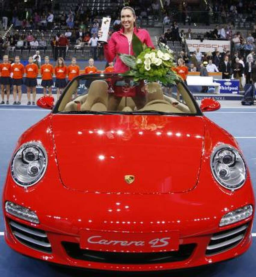 Serbia's Jelena Jankovic poses in a Porsche Carrera 911 Carrera 4S sports car after her victory over Nadia Petrova in the final match of the Porsche Grand Prix. Photo: Matthias Schrader, AP