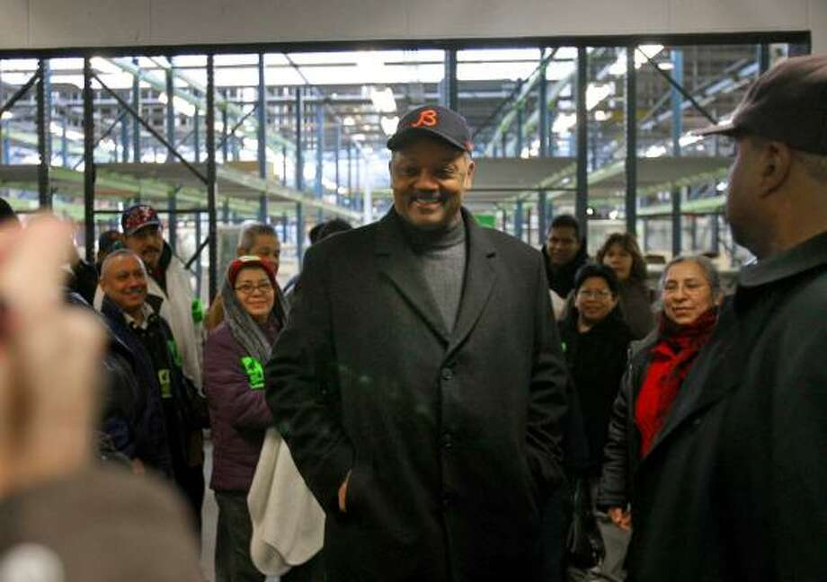 The Rev. Jesse Jackson meets with laid-off workers Sunday who are occupying a Republic Windows and Doors factory in Chicago. Photo: ERIC Y. EXIT, ASSOCIATED PRESS