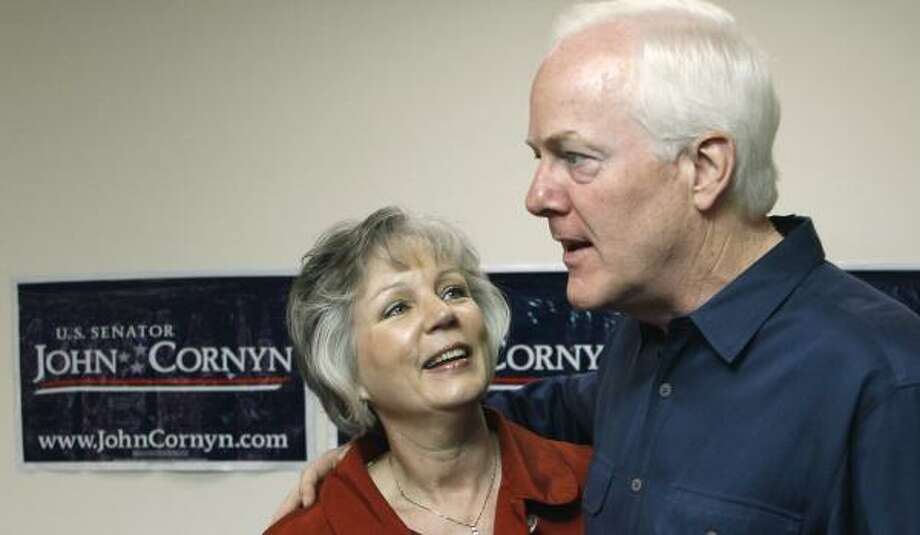 U.S. Sen. John Cornyn, with his wife, Sandy, meets with supporters at the Travis County Republican offices Tuesday. Cornyn told supporters that Republicans need to return to their base values. Photo: HARRY CABLUCK, ASSOCIATED PRESS
