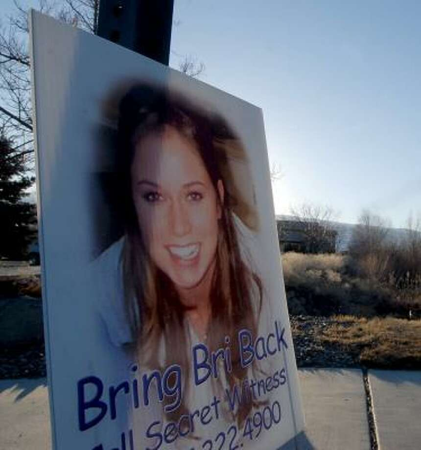 This Feb. 15 photo of a sign shows Brianna Denison, who was later found slain. Photo: KEVIN CLIFFORD, AP PHOTO