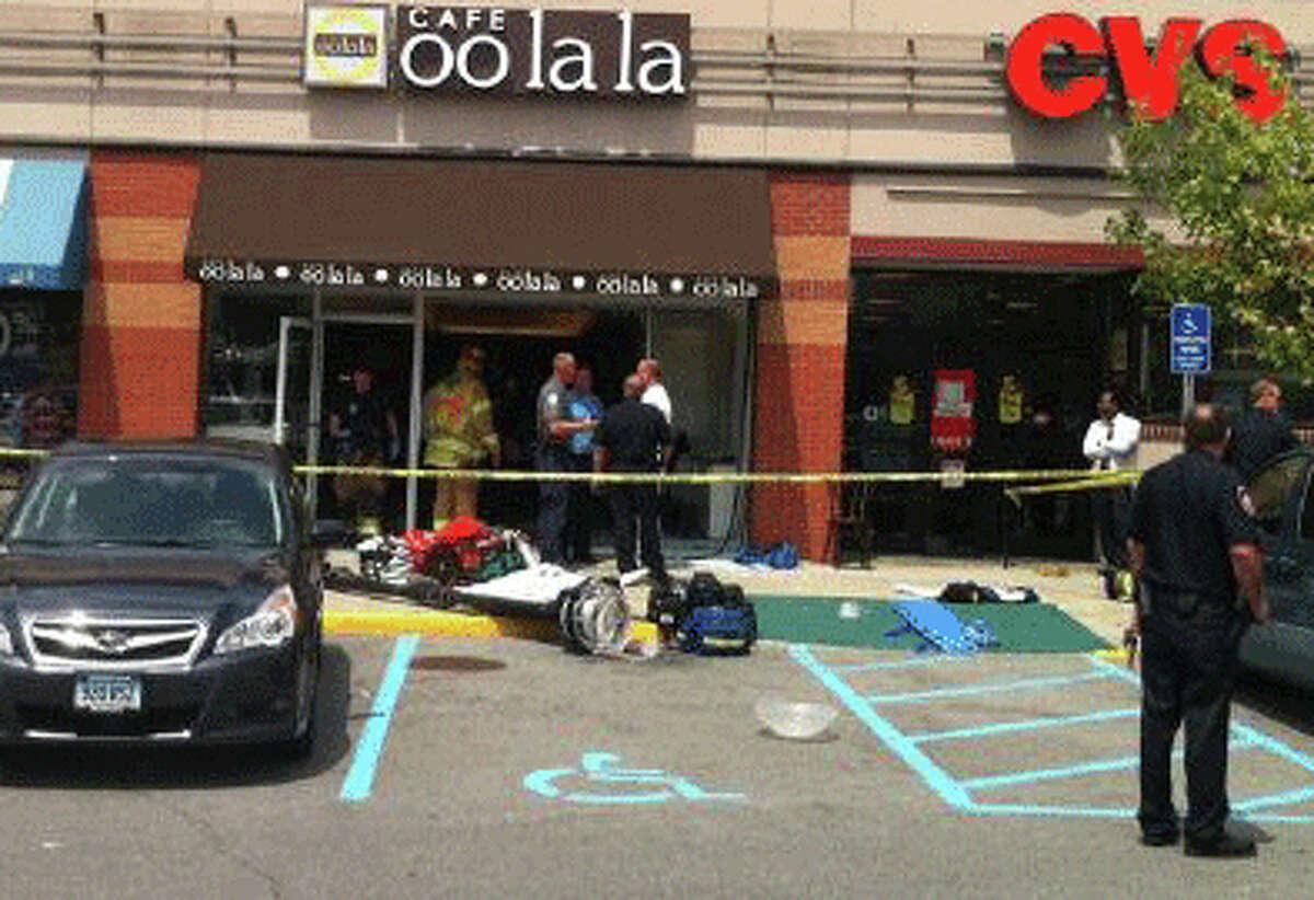 A car barreled through the glass storefront of a Summer Street cafe early Monday afternoon, sending nine people to the hospital.