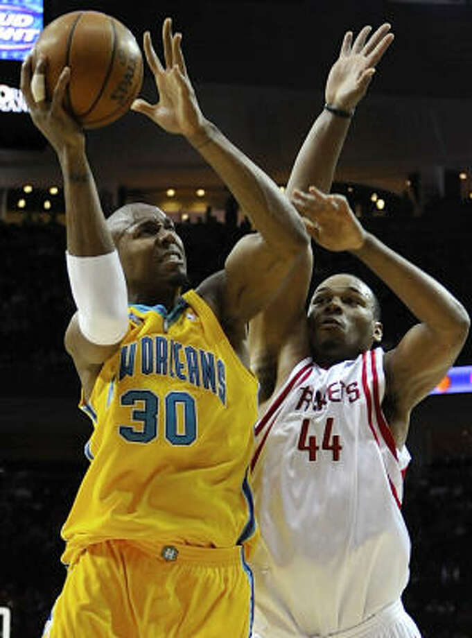 Chuck Hayes had a hard time containing Hornets forward David West, who led New Orleans with 26 points. Photo: Pat Sullivan, AP