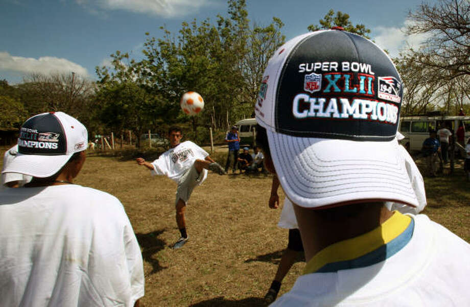 Youngsters in the communities of San Gregorio and Buena Vista were happy to receive Super Bowl shirts and caps declaring the Patriots champions according to Miriam Diaz, spokeswoman for the humanitarian organization World Vision, which arranged the donation with the NFL. Photo: AP