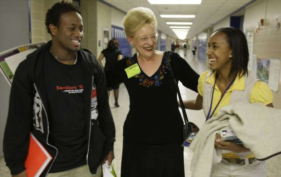 Volunteer Pat Rosenberg, center, visiting with Booker T. Washington High School students Tristan Love, left, and Autumn Green, was saluted by HISD with the Special Lifetime Achievement Award during a breakfast honoring the district's 57,000-plus volunteers. Photo: MELISSA PHILLIP, CHRONICLE