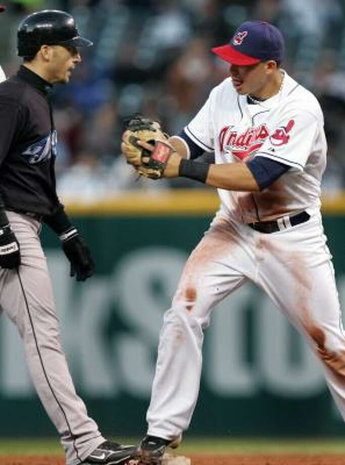Cleveland  Indians second baseman Asdrubal Cabrera, right, steps on second base and then tags out Toronto Blue Jays' Marco Scutaro to complete an unassisted triple play. Photo: Chuck Crow, AP