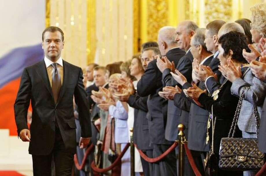 Dmitry Medvedev is applauded as he enters his inauguration ceremony Wednesday in the Kremlin. Photo: DMITRY ASTAKOV, RIA-NOVOSTI