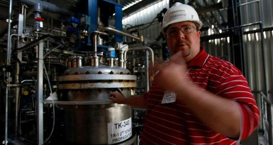 Matthew Musial, an operations manager for Verenium, demonstrates how sugar bagasse is turned into cellulosic ethanol at the company's plant in Jennings, La. Photo: JOHNNY HANSON, CHRONICLE