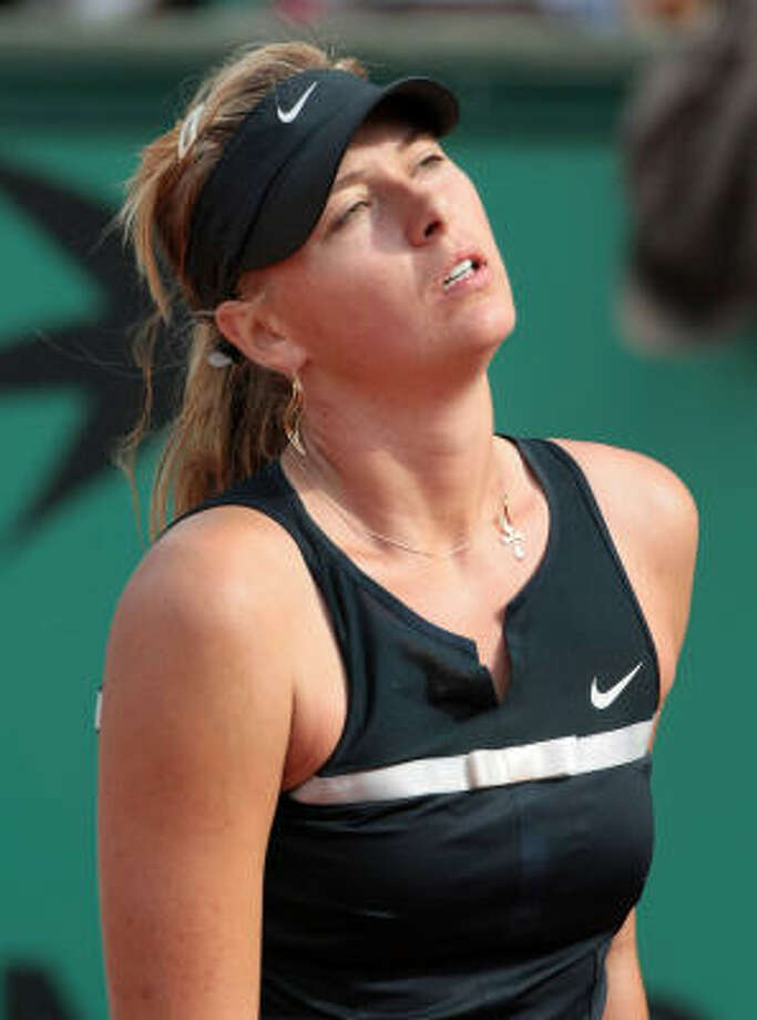 Russian player Maria Sharapova reacts after losing a point to Russian player Dinara Safina during the fourth round of the French Open at Roland Garros in Paris on Monday. Safina won  6-7 (6/8), 7-6 (7/5), 6-2. Photo: JACQUES DEMARTHON, AFP/Getty Images