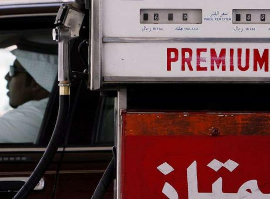 A Saudi man fills his tank at a gas station in Riyadh, Saudi Arabia, where last month President Bush sought a production increase. Photo: HASAN JAMALI, ASSOCIATED PRESS FILE