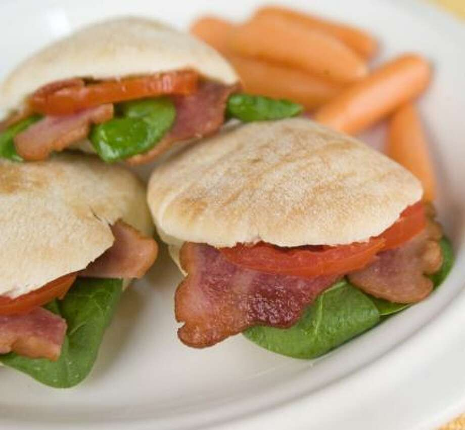 A mini pita pocket — filled with turkey bacon, spinach and tomato — is a major source of nutrition and good taste. Photo: JOHNNY HANSON, CHRONICLE