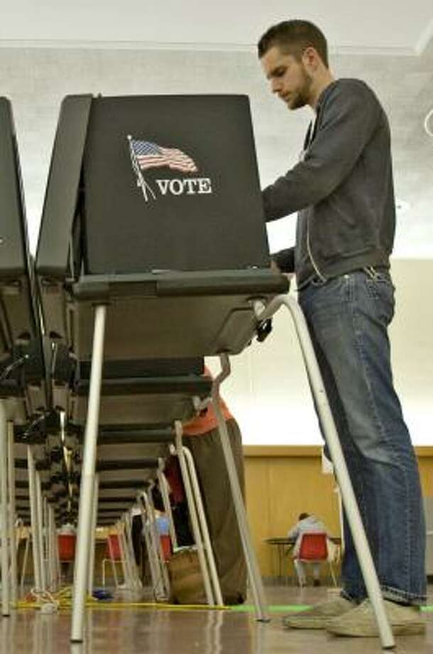Tim Murray fills out an absentee ballot in Columbus, Ohio, on Tuesday. Photo: DAVID SMITH, AP