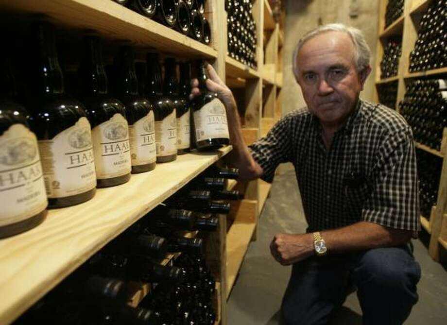 Raymond Haak began growing grapes in 1969 as a hobby. More than 25 years later, he and wife Gladys turned their grape passion into a commercial wine operation. Photo: JULIO CORTEZ PHOTOS:, CHRONICLE