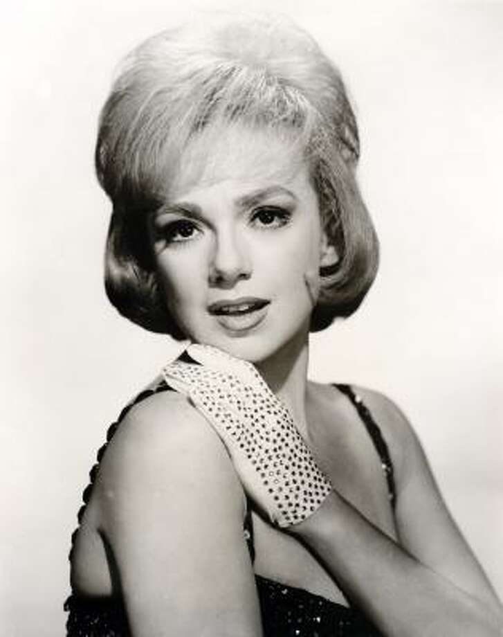 "Edie Adams poses in this 1963 file photo for her variety special ""Here's Edie."" Adams, the blond beauty who won a Tony Award for bringing Daisy Mae to life on Broadway and was television foil for her husband, Ernie Kovacs, died Wednesday in a Los Angeles hospital from pneumonia and cancer, publicist Henri Bollinger said. She was 81. Photo: AP"