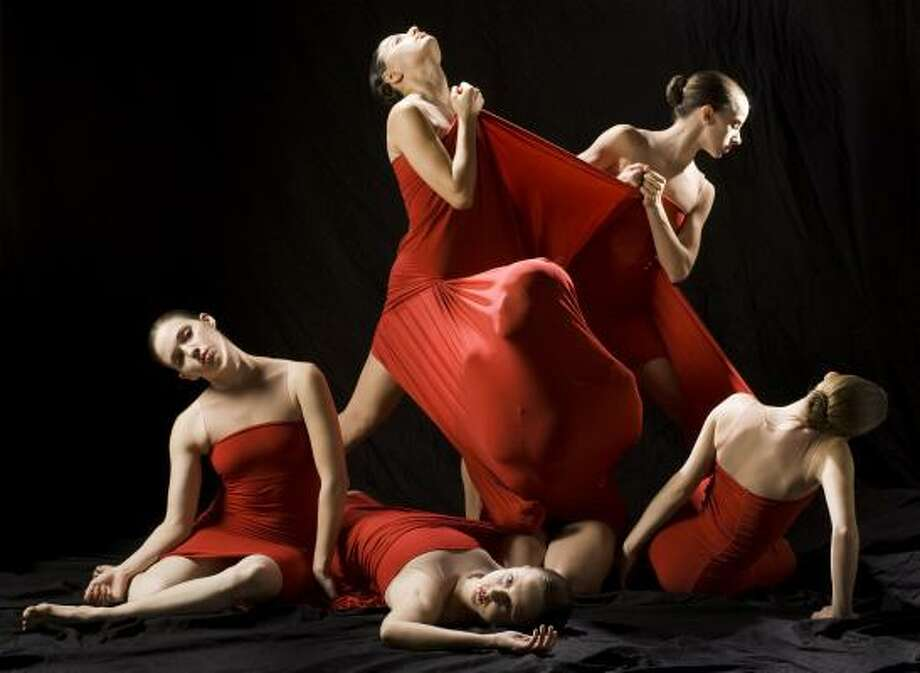 One of the costumes designed by Frederique de Montblanc for Dominic Walsh Dance Theater's new Titus Andronicus is a dress shared by six women who represent the emotionally and physically fractured Lavinia. Clockwise from left are Lauren Bettencourt, Luana Moscagiuli, Lauren Difede, Amanda Herd (back to camera), Dawn Dippel (face covered) and Beth Everitt. Photo: BRETT COOMER, CHRONICLE