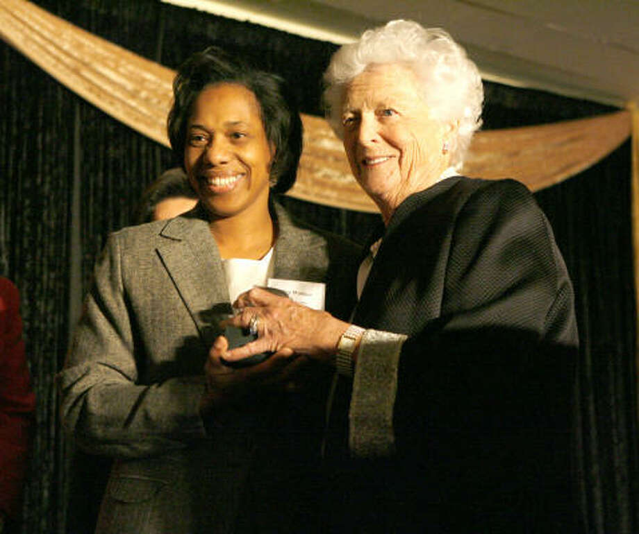 Deetrice Wallace posed with former first lady Barbara Bush in early 2007 after being named Teacher of the Year by the Education Foundation of Harris County. Photo: Steve Campbell, Houston Chronicle