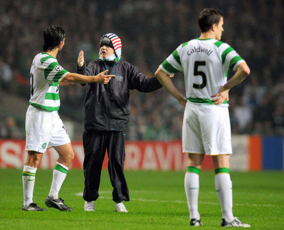 A fan delays the Celtic-Manchester United game at Glasgow, Scotland. Photo: ANDREW YATES, AFP/Getty Images