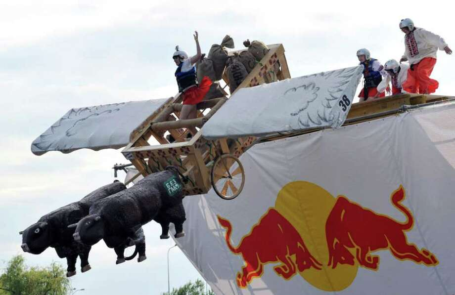 "The ""Tchoomak airlines"" team competes during Red Bull Flugtag 2010 in Kiev on June 19, 2010. Photo: SERGEI SUPINSKY, AFP/Getty Images / 2010 AFP"