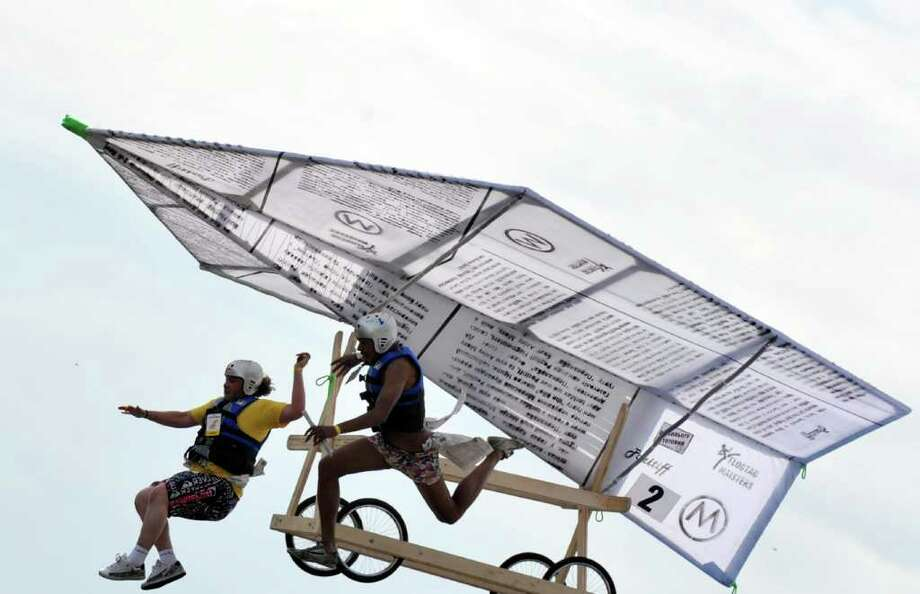 "The ""Pozitiff people"" team competes during Red Bull Flugtag 2010 in Kiev on June 19, 2010. Photo: SERGEI SUPINSKY, AFP/Getty Images / 2010 AFP"