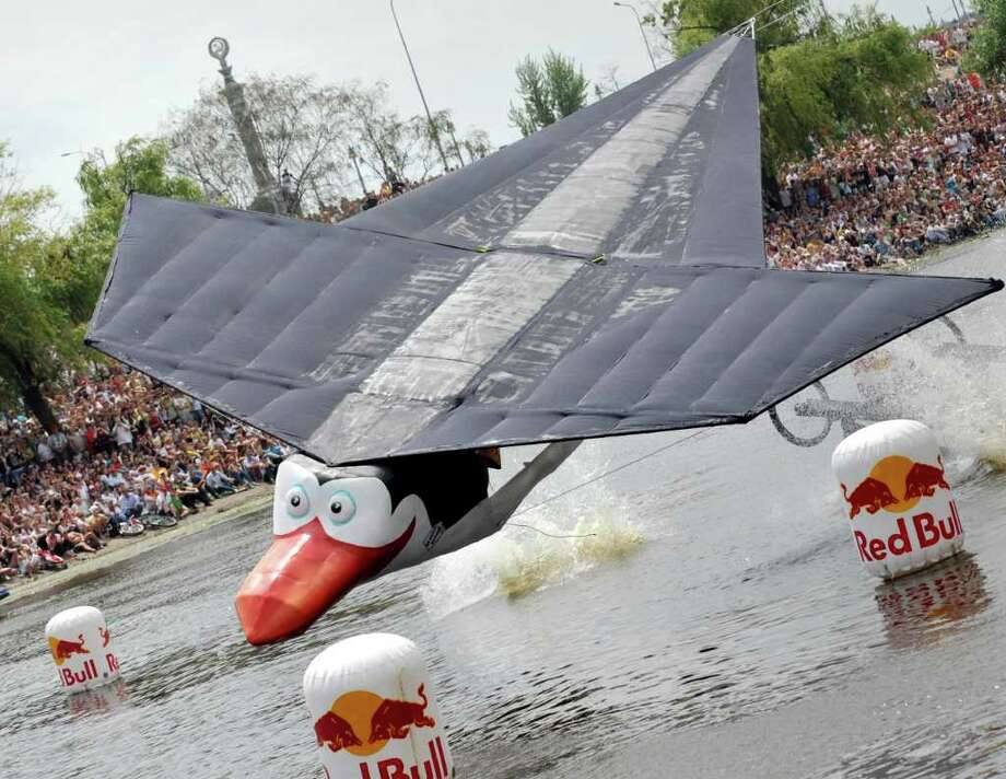 "The ""Penguins of Kiev's Zoo"" team competes during Red Bull Flugtag 2010 in Kiev on June 19, 2010. Photo: SERGEI SUPINSKY, AFP/Getty Images / 2010 AFP"