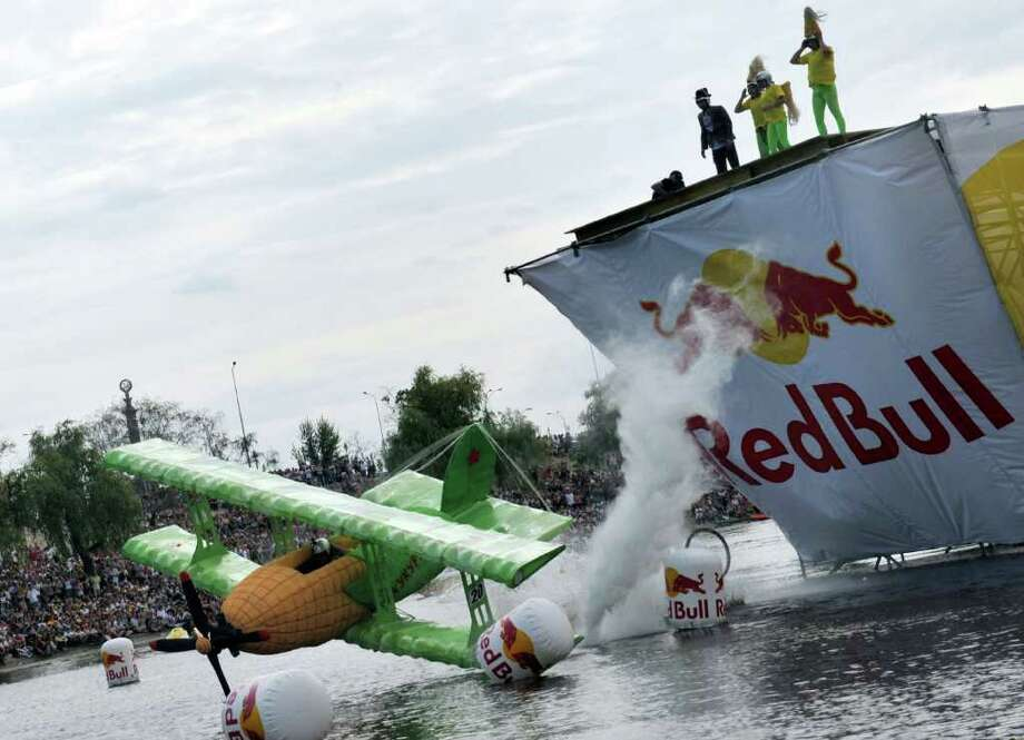 "The ""Kuzka's mother"" team competes during Red Bull Flugtag 2010 in Kiev on June 19, 2010. Photo: SERGEI SUPINSKY, AFP/Getty Images / 2010 AFP"