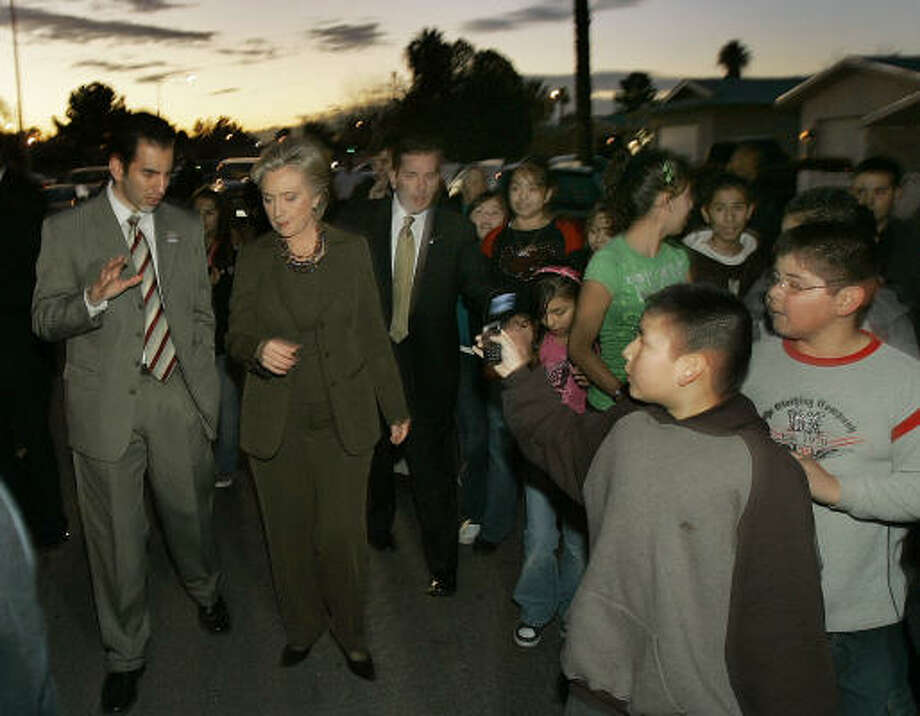 Joesly Bermudez, 10, takes a cell phone photo of Hillary Rodham Clinton touring a Las Vegas neighborhood with Nevada state Assemblyman Ruben Kihuen on Thursday. Photo: Elise Amendola, Associated Press
