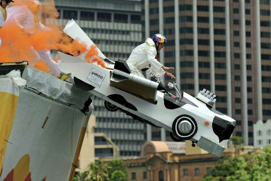 "Pilot Hank Opdam guides the Cadillac of his ""4 Fat Elvises"" team entry off the ramp during the Red Bull Flugtag event in Sydney on November 7, 2010. Photo: GREG WOOD, AFP/Getty Images / 2010 AFP"