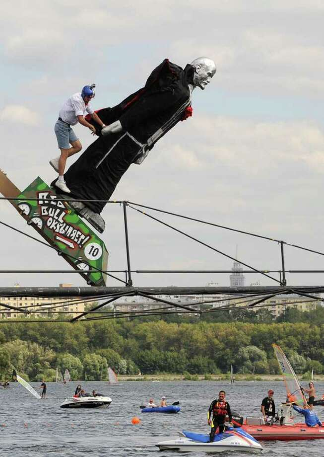 "Moscow just hosted the latest Red Bull ""Flugtag"" (""flying day,"" in German) competition, in which teams send human-powered flying machines off a 30-foot-high deck. Teams get points for distance and style, although most seem to concentrate on the latter. Here, the ""Ilich Square"" team (Ilich was Lenin's middle name) competes in Moscow on August 7, 2011.  Photo: NATALIA KOLESNIKOVA, AFP/Getty Images / 2011 AFP"