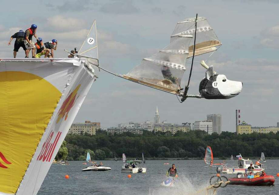 "The ""Belka and Strelka"" team competes during the Red Bull Flugtag event in Moscow on August 7, 2011.  Photo: NATALIA KOLESNIKOVA, AFP/Getty Images / 2011 AFP"