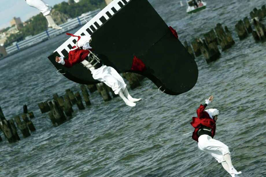 "Members of the ""Flying Mozarts from Austria"" splash down before their piano on October 5, 2003 in New York. Photo: Chris Hondros, Getty Images / 2003 Getty Images"