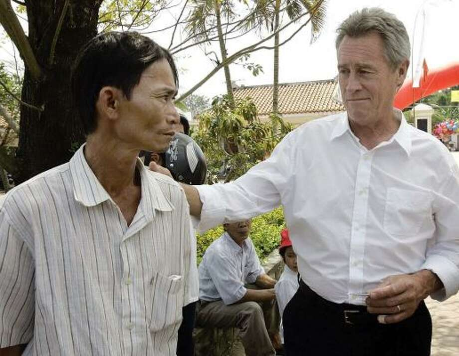 My Lai massacre survivor Do Ba meets with former Army officer Lawrence Colburn, who rescued him 40 years ago. They were among hundreds who gathered in My Lai to remember the grim milestone of the Vietnam War. Photo: CHITOSE SUZUKI, ASSOCIATED PRESS