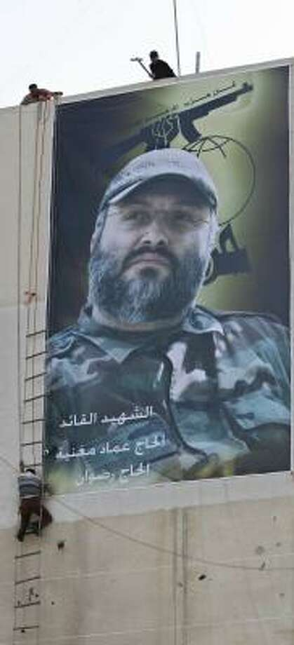 A poster of slain Hezbollah chief Imad Mughniyah is emblazoned on a building in Tyre, Lebanon. Photo: MOHAMMED ZAATARI, ASSOCIATED PRESS