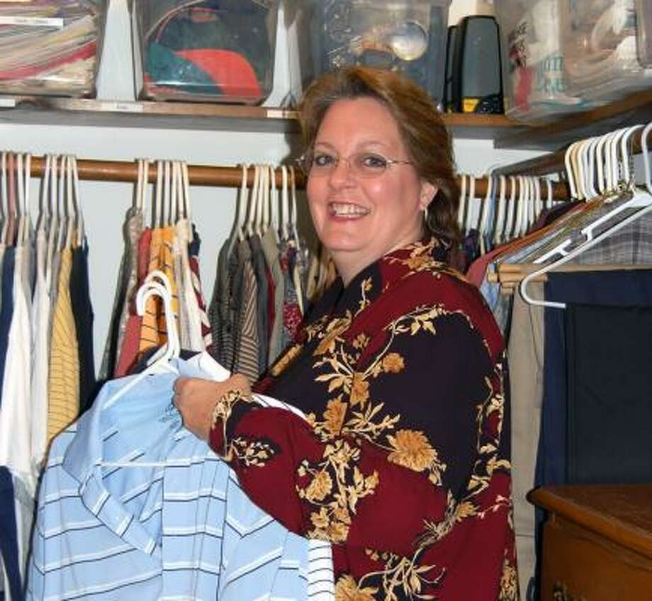 Susan Wade organizes a closet. Photo: WENDY RUDNICKI, FOR THE CHRONICLE