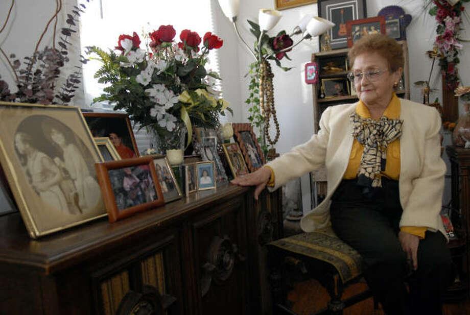 Hermelinda Hernandez, 79, poses photos of her children and grandchildren and is Houston's 'oldest' federally certified judicial interpreter. Photo: Kim Christensen, Houston Chronicle