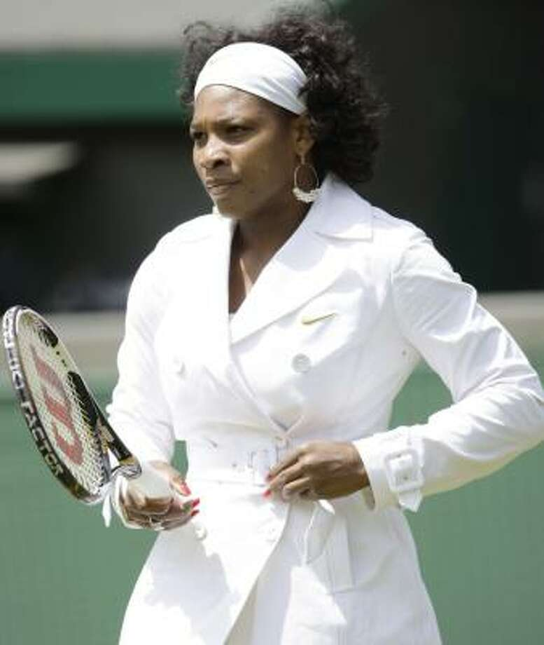 Serena Williams abandoned her raincoat after warmups on a sunny first day at Wimbledon. Photo: ALASTAIR GRANT, ASSOCIATED PRESS