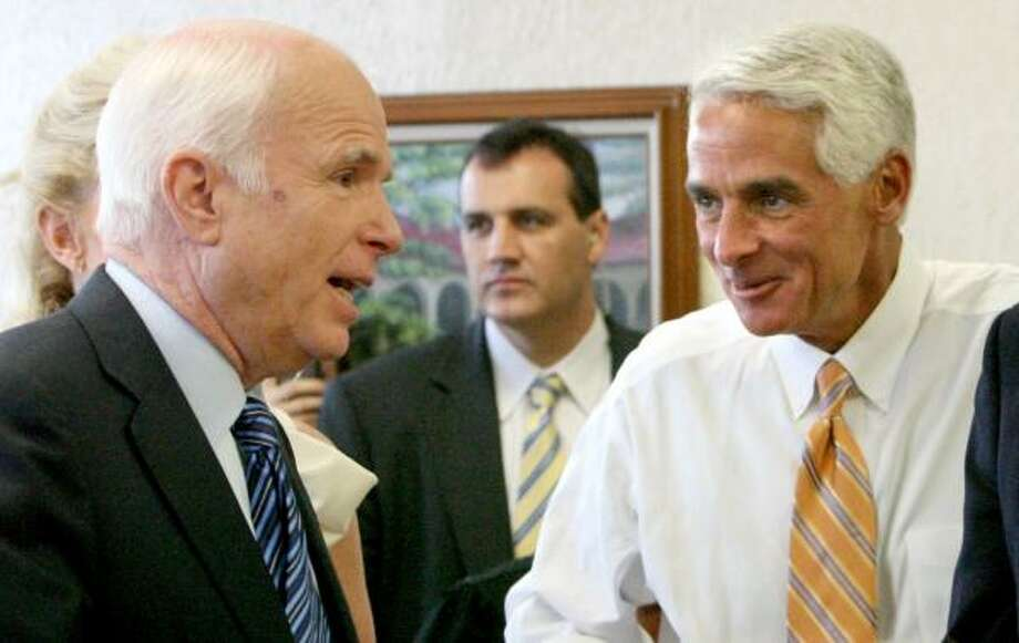 John McCain, left, meets with Florida Gov. Charlie Crist on Friday. After Obama clinched the nomination in June, McCain challenged him to 10 town hall meetings. Photo: JOE BURBANK PHOTOS, ORLANDO SENTINEL